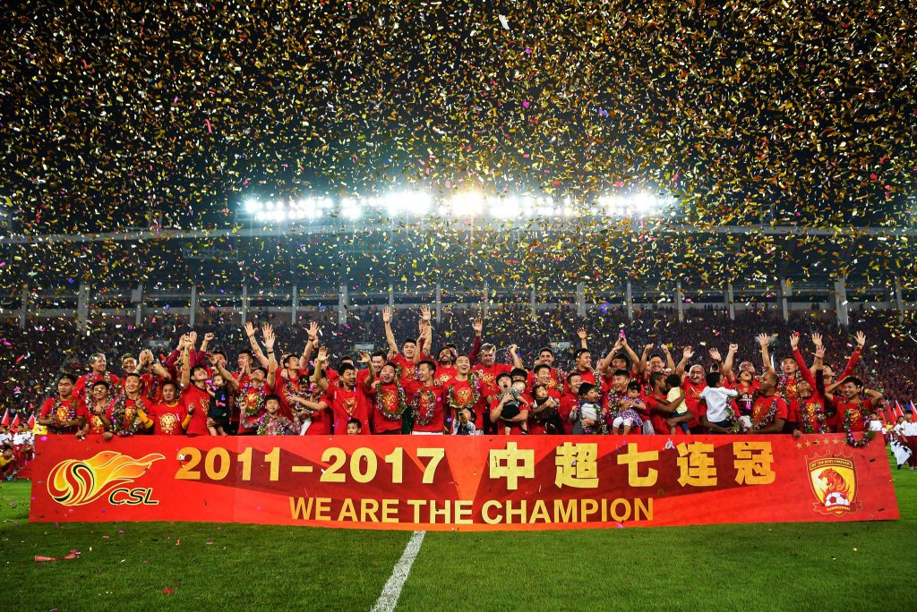 Guangzhou Evergrande players celebrate after winning the Chinese Super League (CSL)