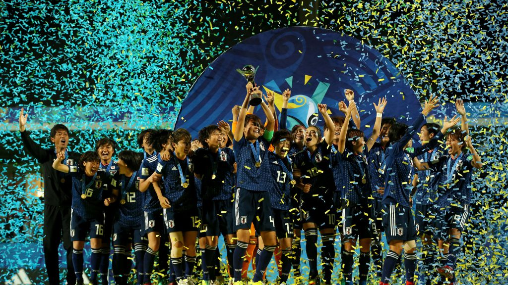 Japan football players celebrating