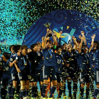 Japan football players celebrating